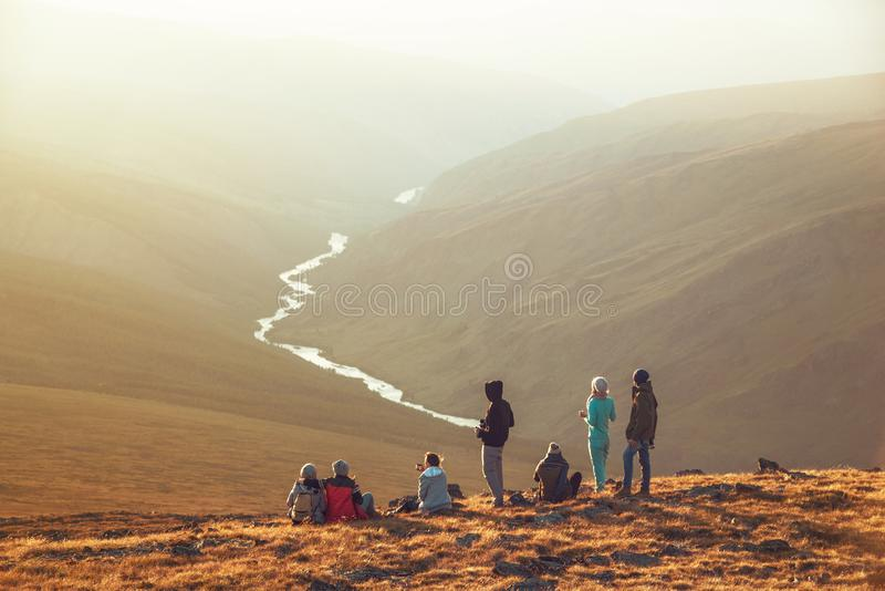 Big group tourists hikers mountain top viewpoint stock images