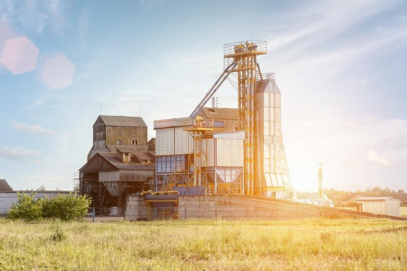 Big group of grain dryers complex for drying wheat. Modern grain silo. Agriculture concept stock images