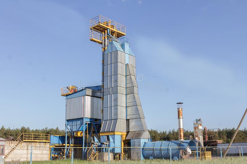 Big group of grain dryers complex for drying wheat. Modern grain silo. Agriculture concept royalty free stock photo
