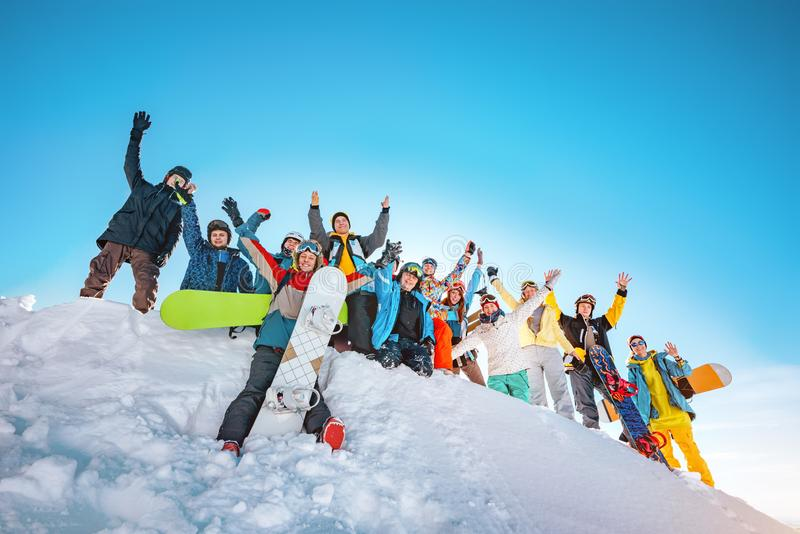 Big group of skiers and snowboarders at ski resort stock photography