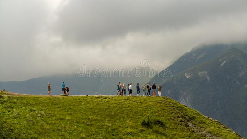 Travelers stand on a mountain and look around at nature royalty free stock photo