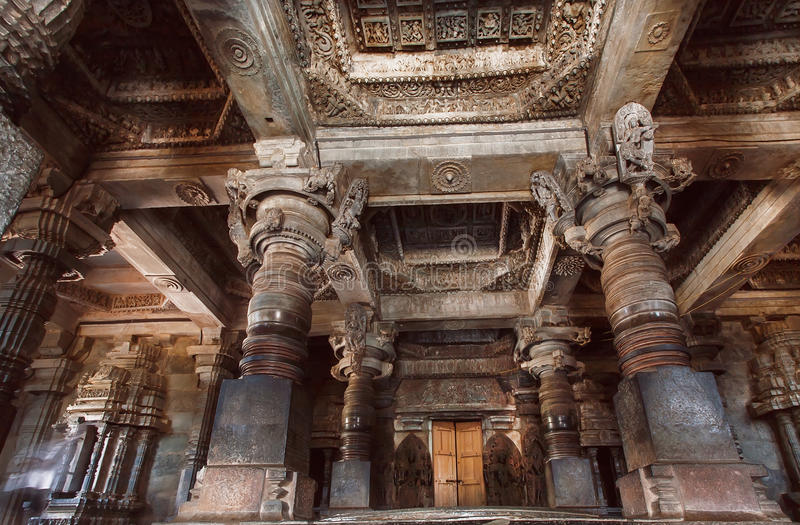 Big hall with stone columns inside the temple in India. Temple built in 12th century. Big hall with stone columns inside the traditional hindu temple in India royalty free stock photo