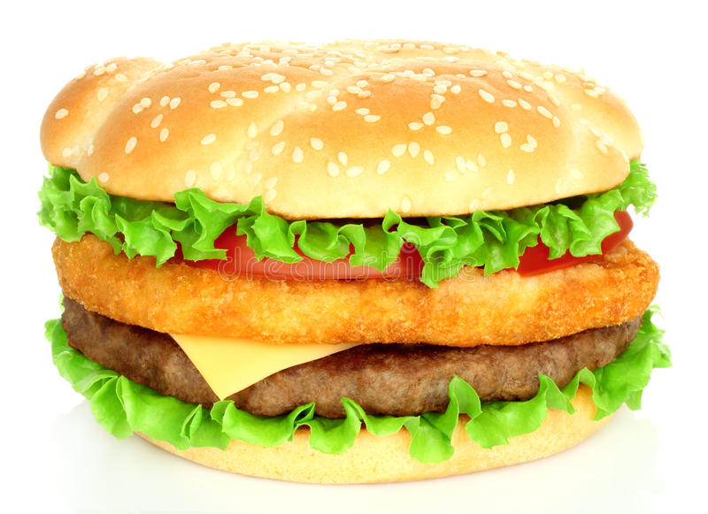 Big hamburger with chicken and beef cutlets stock image