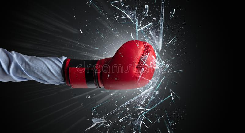 Hand hits intense and breaks glasses stock image