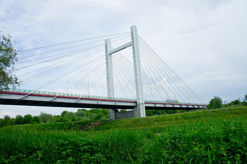 Big handsome cable-stayed bridge over the river against the sky stock image
