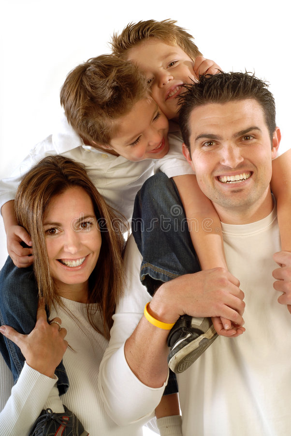 Big, happy family. Attractive, modern young family hugging and laughing together
