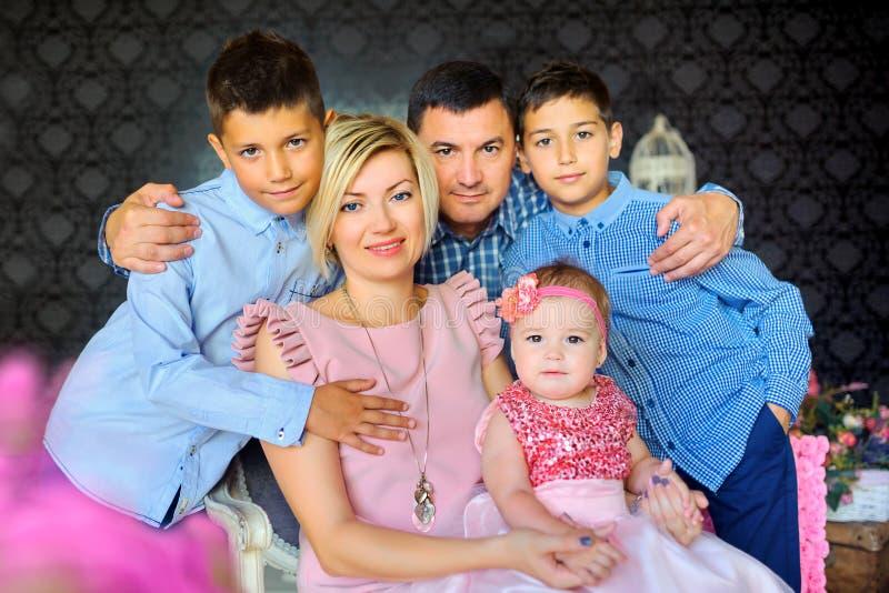 Big happy family amicably hug stock image