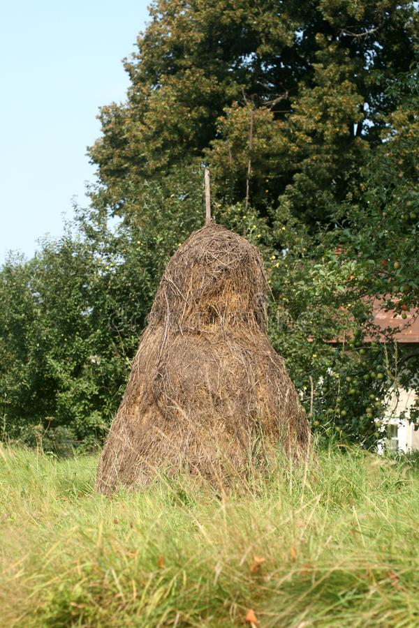 Big haystack. The countryside. Grass and trees. Big haystack. The countryside. Grass and trees stock image