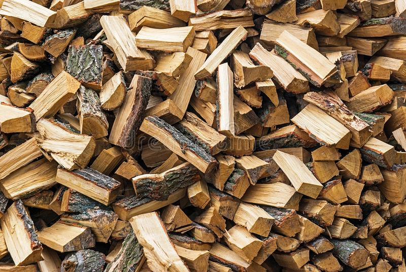Big heap of brown firewood. Settled at the yard in the village stock images