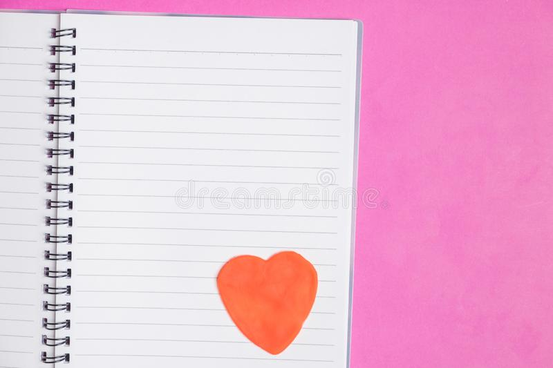 Big heart in blank book on pink background with space for text, Love icon, valentine`s day. Big 2 hearts in blank book on pink background with space for text stock images