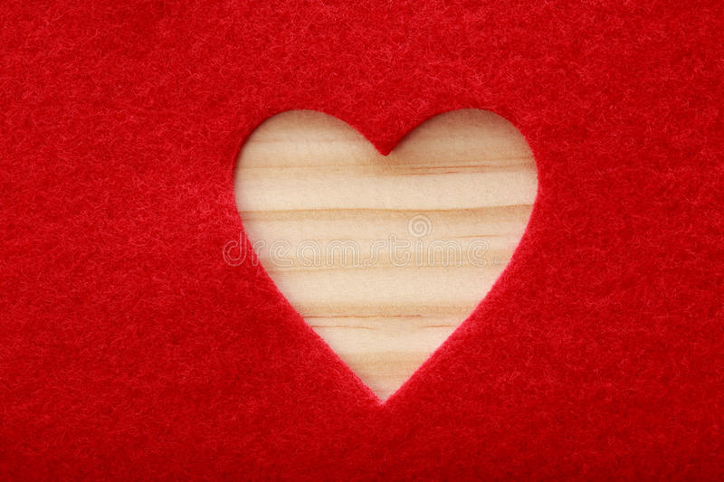 Big heart cut out of red felt stock images