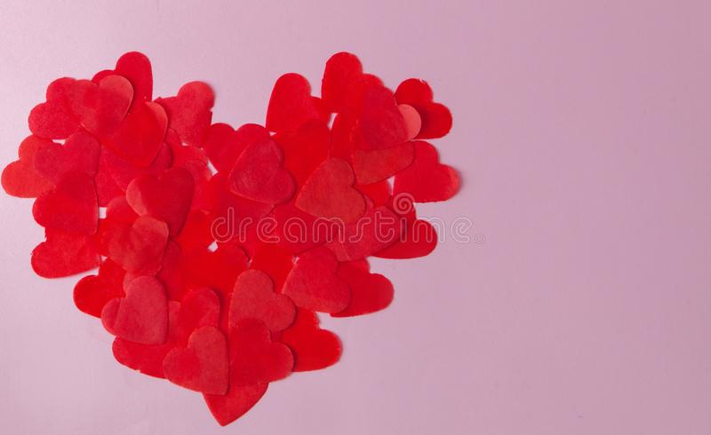 Big heart made from little paper hearts on pink background. Valentine s Day, love symbol stock photography