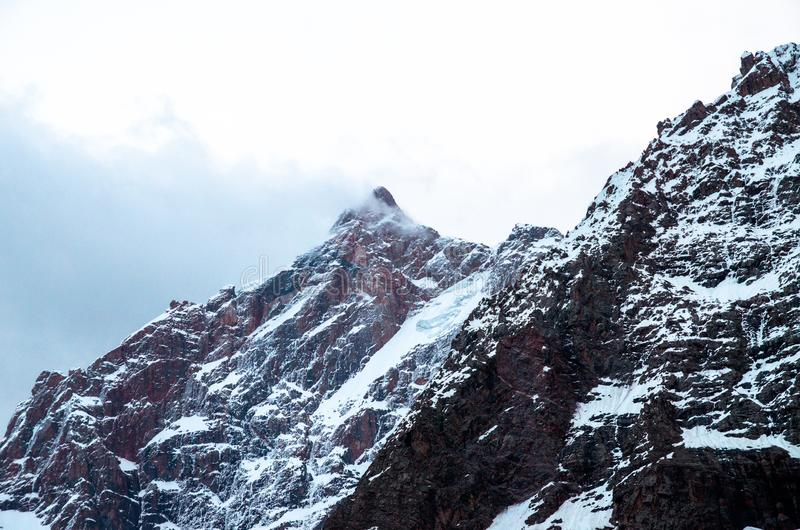 Big and high mountains in Central Asia, Tajikistan. with snow adn clounds royalty free stock images