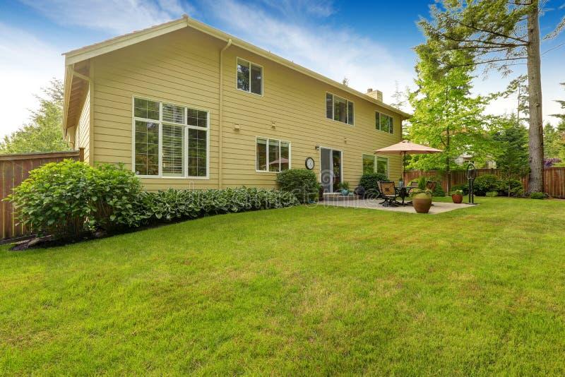 Big house with backyard patio royalty free stock photos