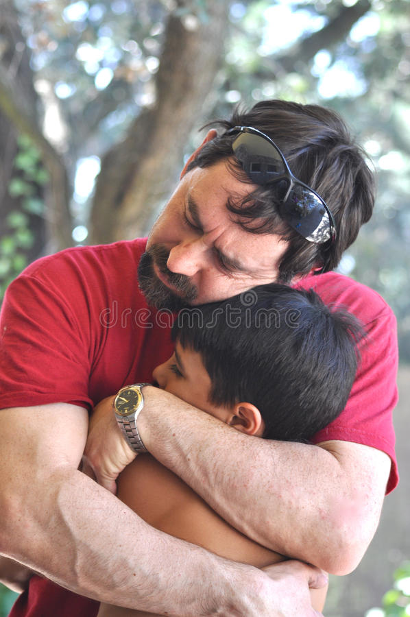 Big Hug. A father is hugging his child, comforting him