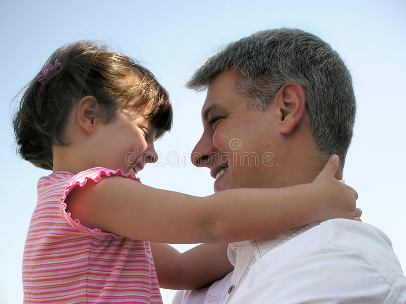 Big hug. Little girl hugging her daddy