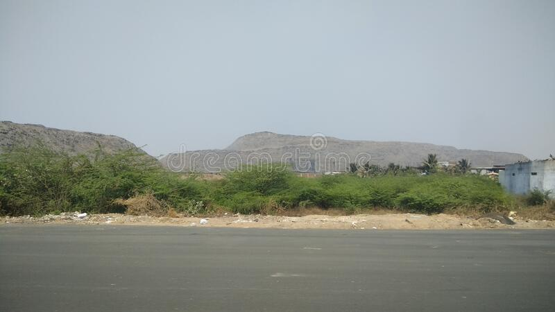 Big huge mountain like garbage pile outside city of Ahmedabad India. Big huge mountain like garbage pile outside city of Ahmedabad royalty free stock photo