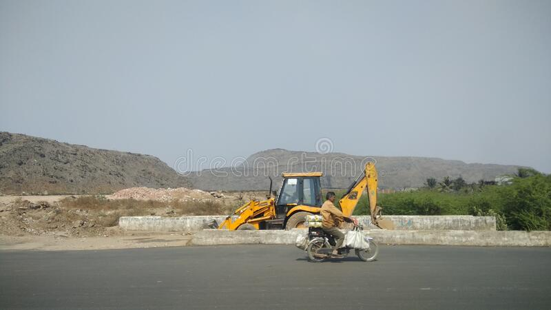 Big huge mountain like garbage pile outside city of Ahmedabad India. Big huge mountain like garbage pile outside city of Ahmedabad stock photography