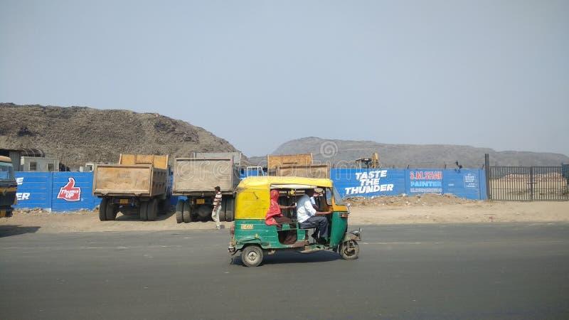 Big huge mountain like garbage pile outside city of Ahmedabad India. Big huge mountain like garbage pile outside city of Ahmedabad stock images