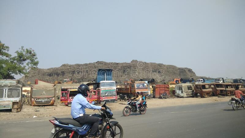 Big huge mountain like garbage pile outside city of Ahmedabad India. Big huge mountain like garbage pile outside city of Ahmedabad royalty free stock photos