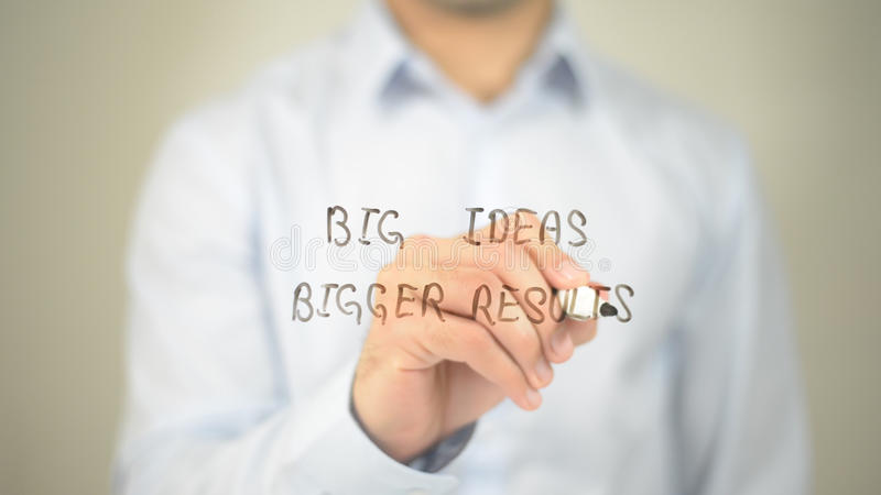 Big Ideas Bigger Results , man writing on transparent screen royalty free stock images