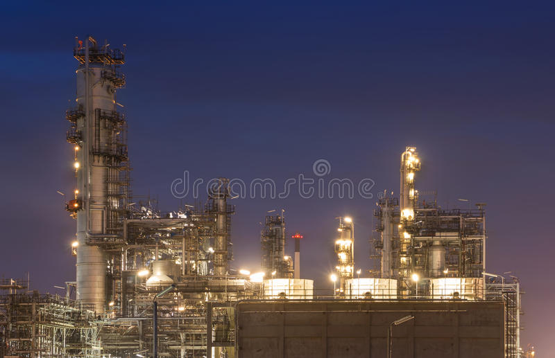 Big Industrial oil tanks in a refinery. With treatment pond at industrial plants stock image