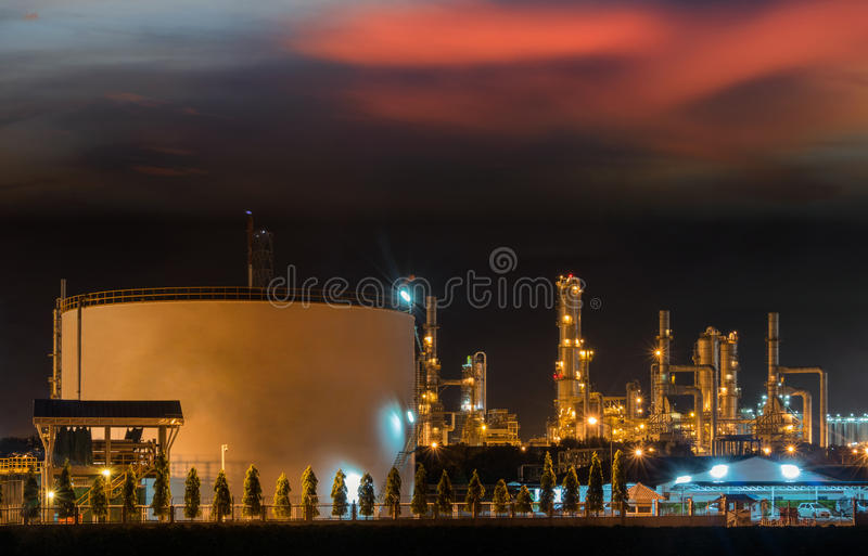 Big Industrial oil tanks in a refinery. With treatment pond at industrial plants royalty free stock images