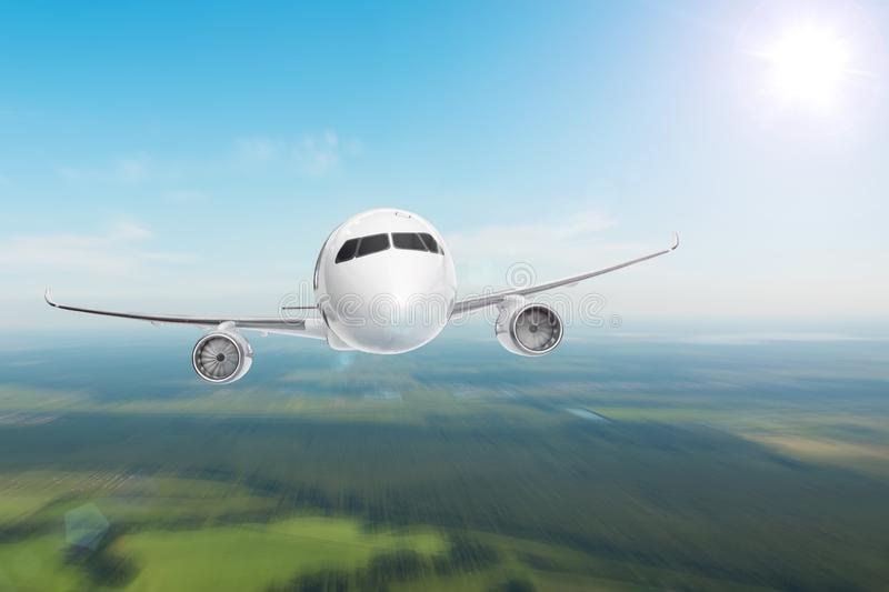 Big jet airplane flying on blur motion sky background below ground, gaining height stock photography
