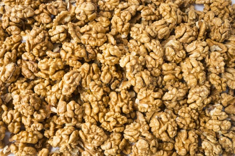 Big kernels walnuts situated arbitrarily. Closeup of big shelled walnuts. Walnut background, scattered pile of walnuts. Kernels wa stock photo