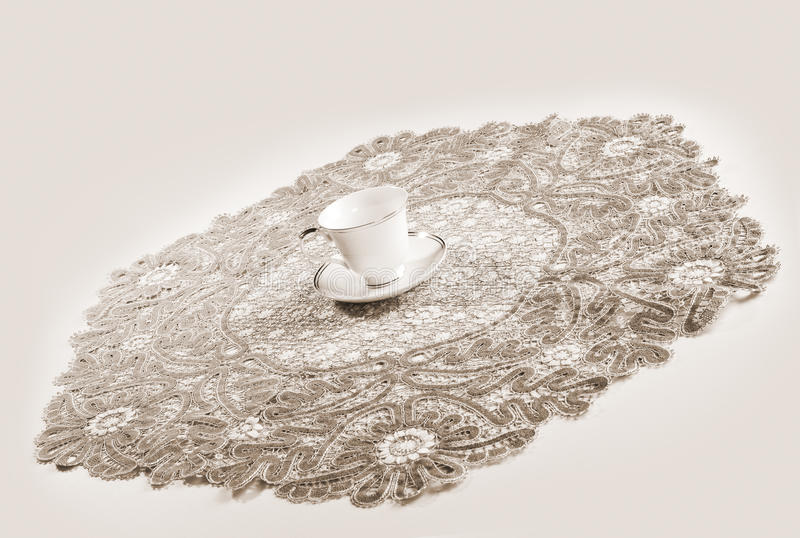 Download Big Lacy Tablecloth And Cup Royalty Free Stock Image - Image: 17122526