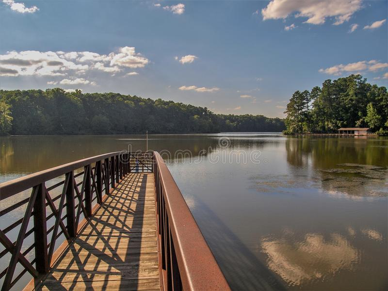 Big Lake at William B. Umstead State Park. William B. Umstead State Park in Raleigh, North Carolina has more than twenty miles of trails and three lakes stock image