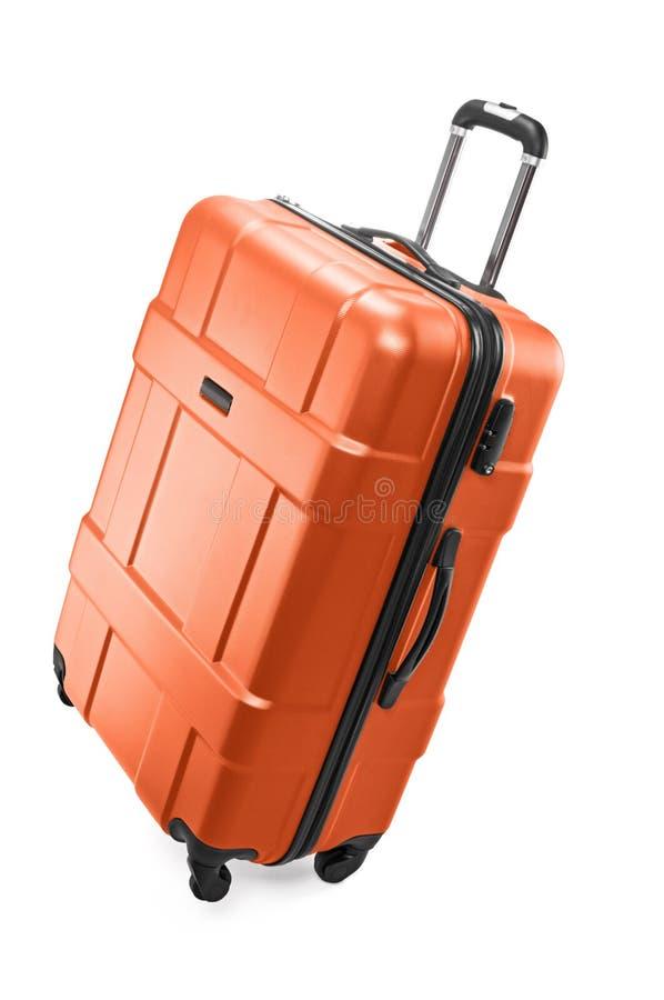 Big luggage bag. Big orange plastic luggage bag with wheels for travel stock images
