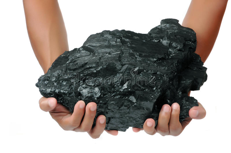 A big lump of coal is held with two hands. Isolated on white background stock images