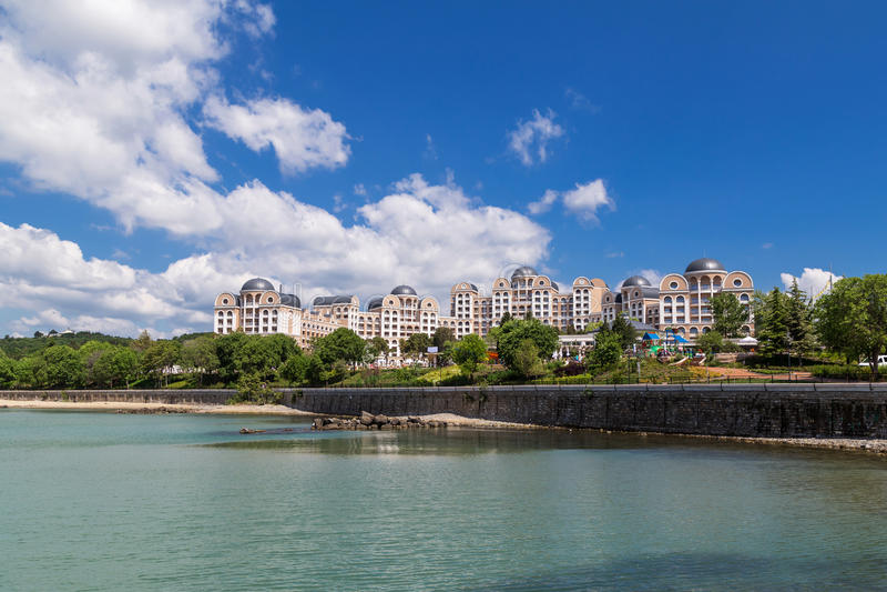 Big luxury hotel on the sea coast royalty free stock photography