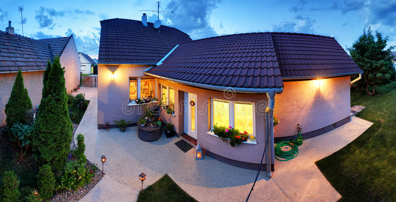 Big luxury house at dusk, night, panorama royalty free stock photography