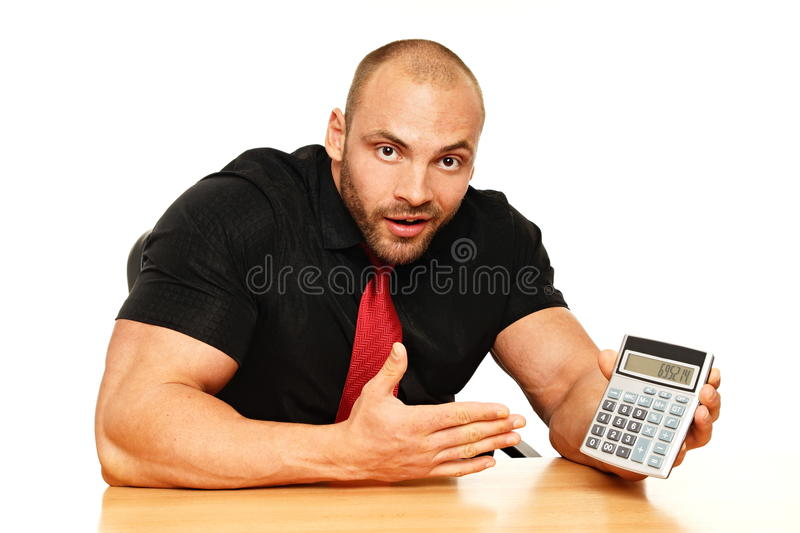 Big man with calculator. Surprised man with calculator shows you the calculation royalty free stock photography