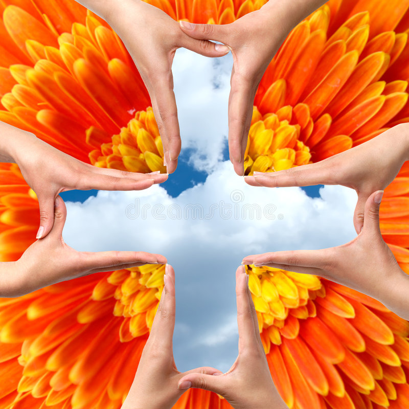 Big Medical Cross symbol from hands isolated. Female hands showing big medical cross symbol concept blue cloudy sky orange daisy flower background stock images