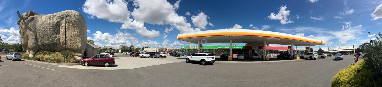 The Big Merino of Goulburn and Shell gas petrol station. Panoramic image of popular iconic monument in Goulburn next to Shell station. There is a large tourist stock photo