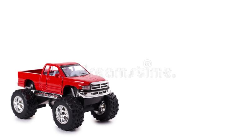 big metal red toy car offroad with monster wheels isolated on white background. copy space, template stock photos