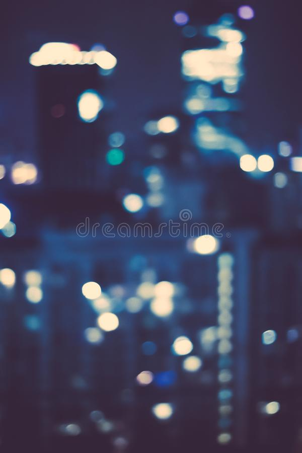 Big metropolitan city lights at night, blurry background. Night life, abstract background and modern dark tones concept royalty free stock images