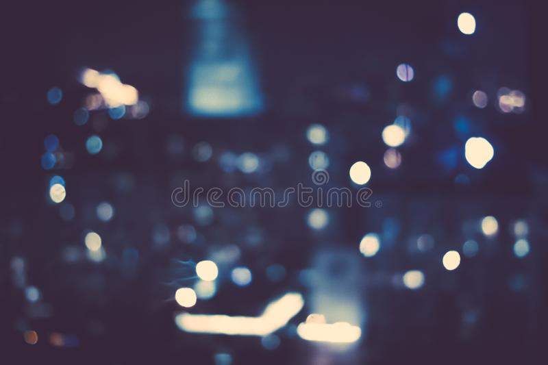Big metropolitan city lights at night, blurry background. Night life, abstract background and modern dark tones concept royalty free stock photo