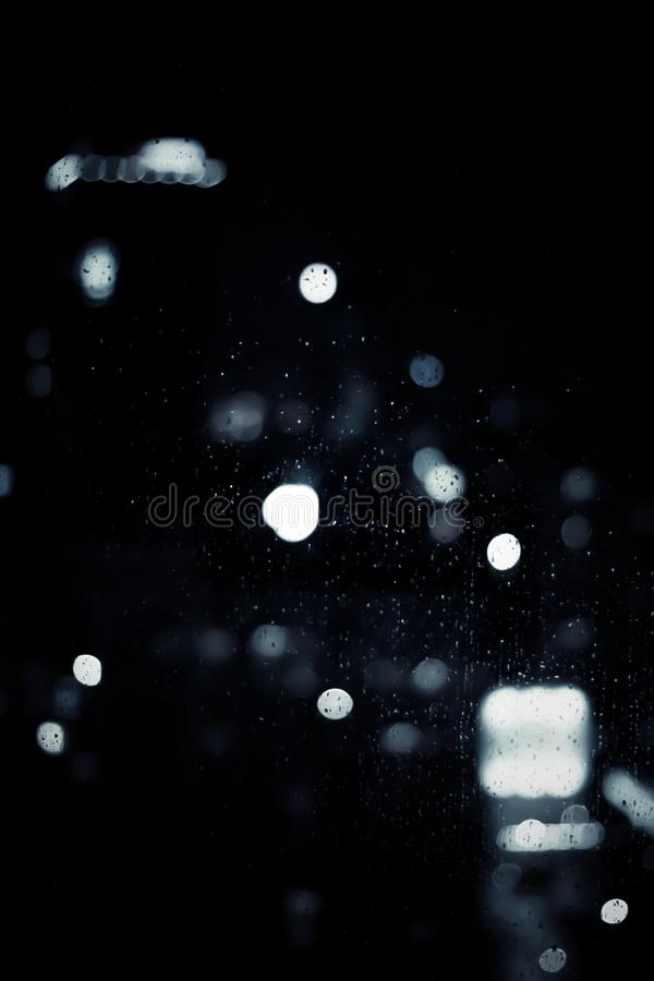 Big metropolitan city lights at night, blurry background. Night life, abstract background and modern dark tones concept stock photos
