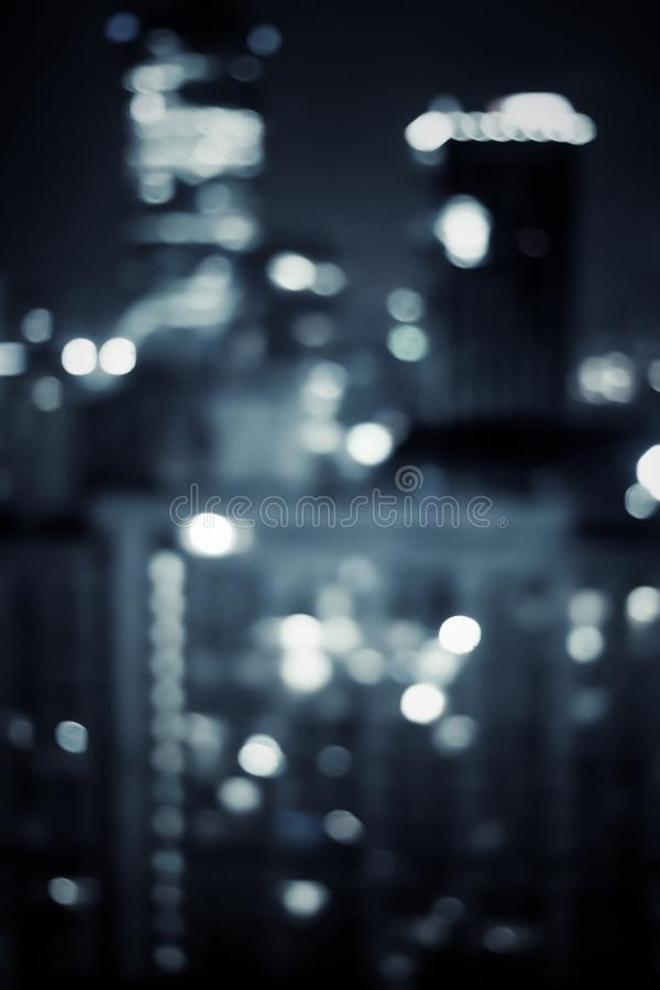 Big metropolitan city lights at night, blurry background. Night life, abstract background and modern dark tones concept stock images
