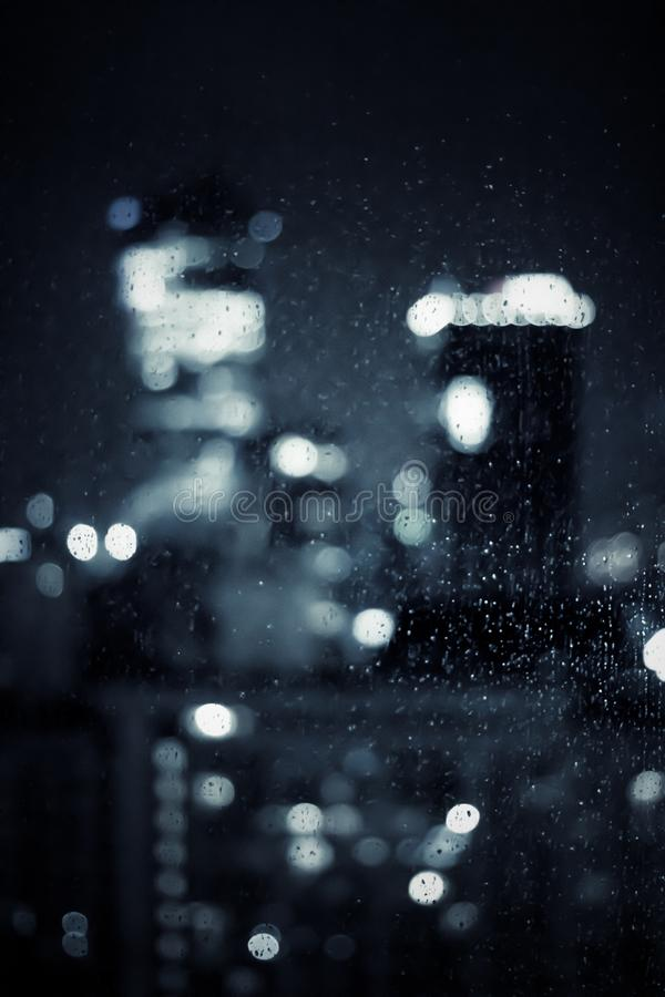 Big metropolitan city lights at night, blurry background. Night life, abstract background and modern dark tones concept royalty free stock photography