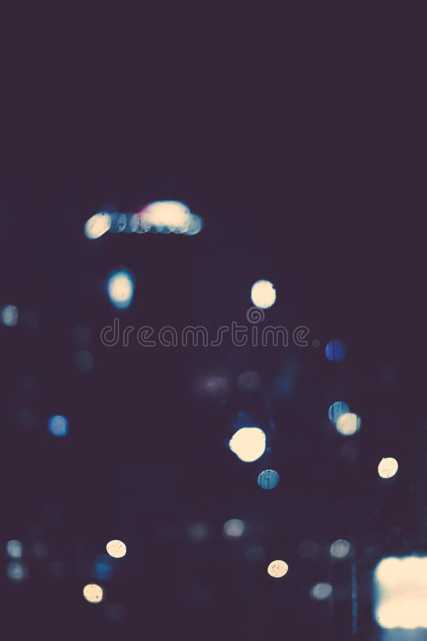 Big metropolitan city lights at night, blurry background. Night life, abstract background and modern dark tones concept royalty free stock photos