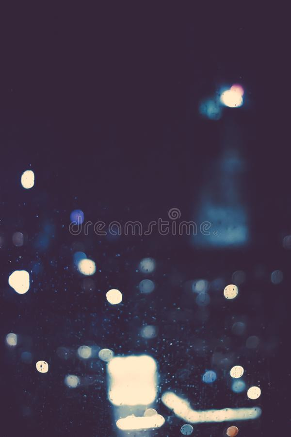 Big metropolitan city lights at night, blurry background. Night life, abstract background and modern dark tones concept stock photography