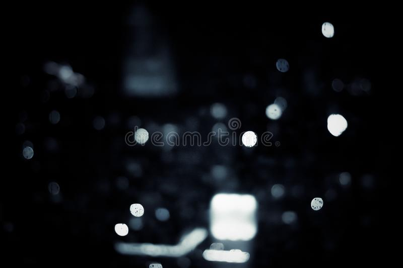 Big metropolitan city lights at night, blurry background. Night life, abstract background and modern dark tones concept royalty free stock image