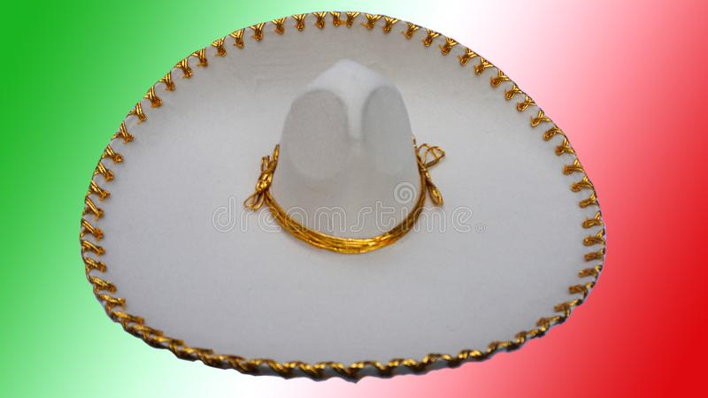 Mexican hat,. Big mexican hat with some details in golden, charro hat made of a palm filaments and golden seams, decorated with golden ribbons stock illustration