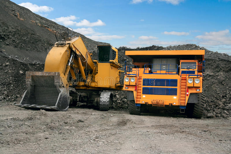 Big mining truck and excavator royalty free stock photos
