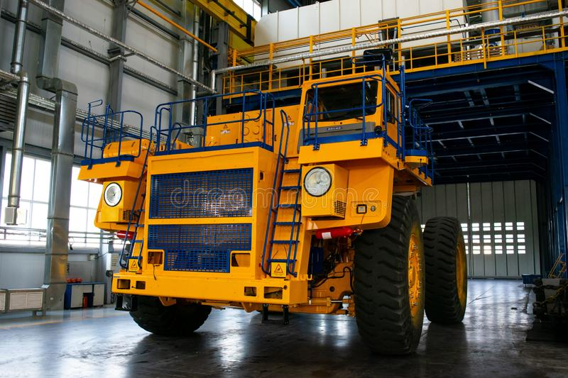 Big mining truck in the production shop of the car factory royalty free stock image